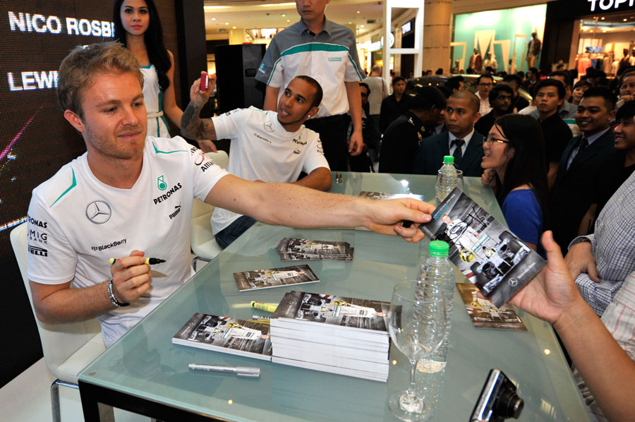 Lewis Hamilton and Nico Rosberg sign autographs in Kuala Lumpur