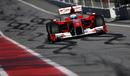 Fernando Alonso makes his way down the pit lane