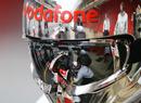 Lewis Hamilton and McLaren practice a pit stop