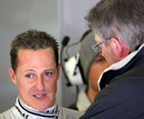Michael Schumacher talks with Ross Brawn
