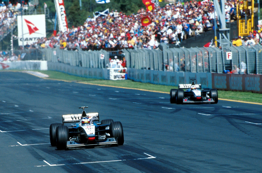 David Coulthard pulls over to let team-mate Mika Hakkinen through to win
