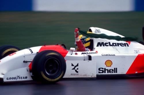 Ayrton Senna celebrates his win at Donington Park