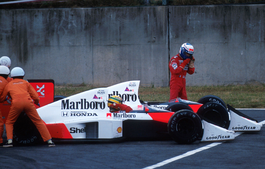 Alain Prost walks away from his McLaren following a collision with team-mate Ayrton Senna