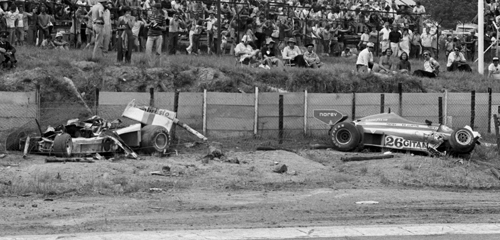The remains of the Shadow DN8 of Tom Pryce sit in the catch fencing