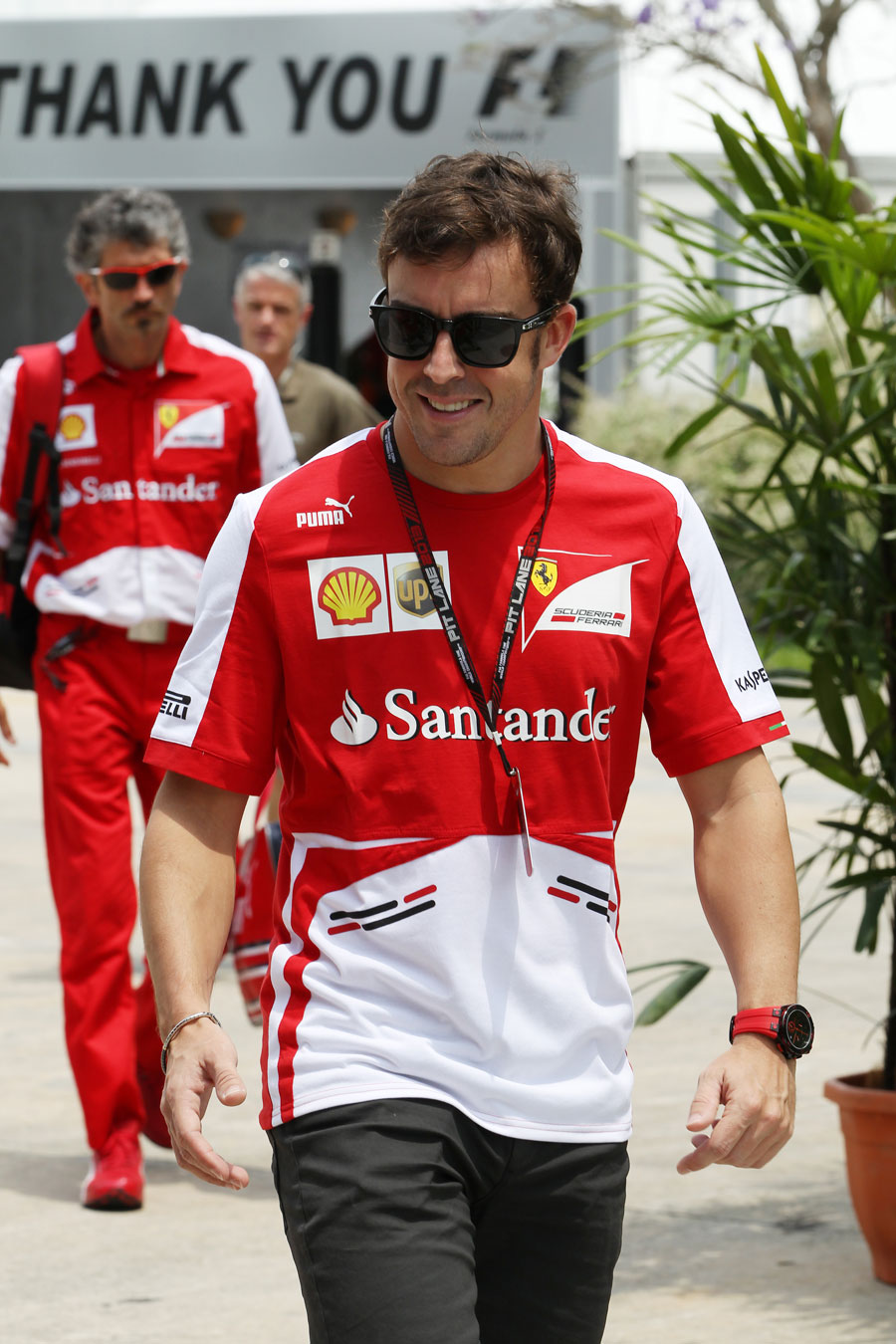 Fernando Alonso is all smiles in the Sepang paddock