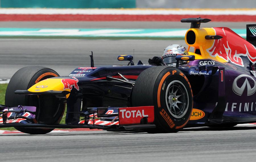 Sebastian Vettel aims for an apex on the hard tyres