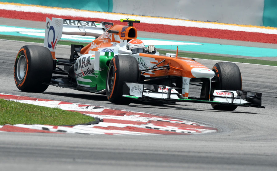 Adrian Sutil tackles turn one