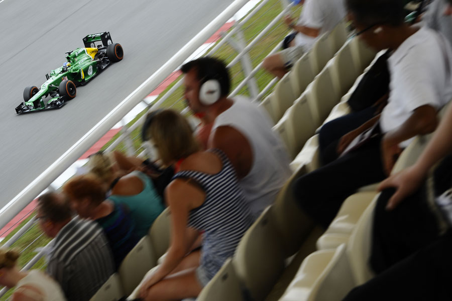 Charles Pic speeds past the fans in the grandstands
