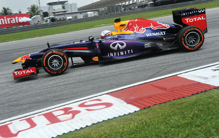 Sebastian Vettel rounds turn two