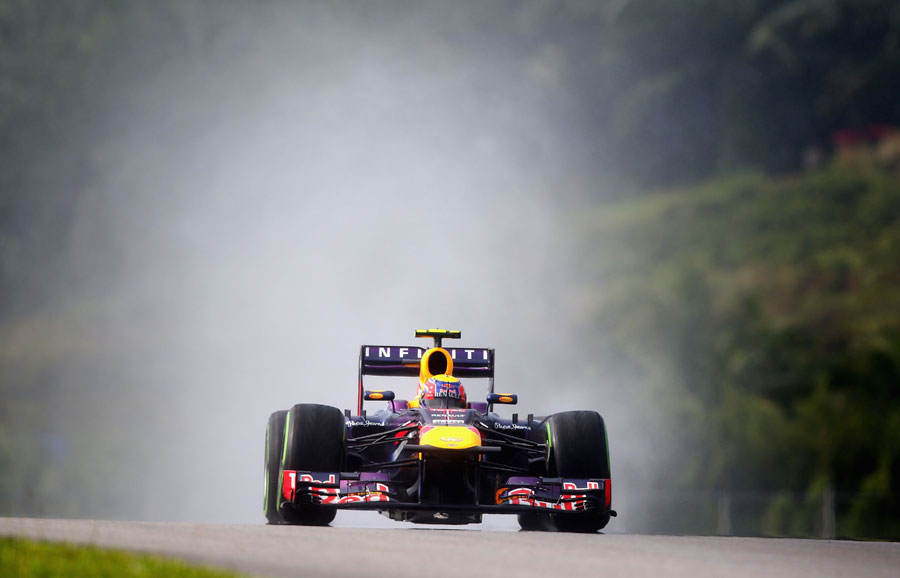Mark Webber on the intermediate tyre during qualifying