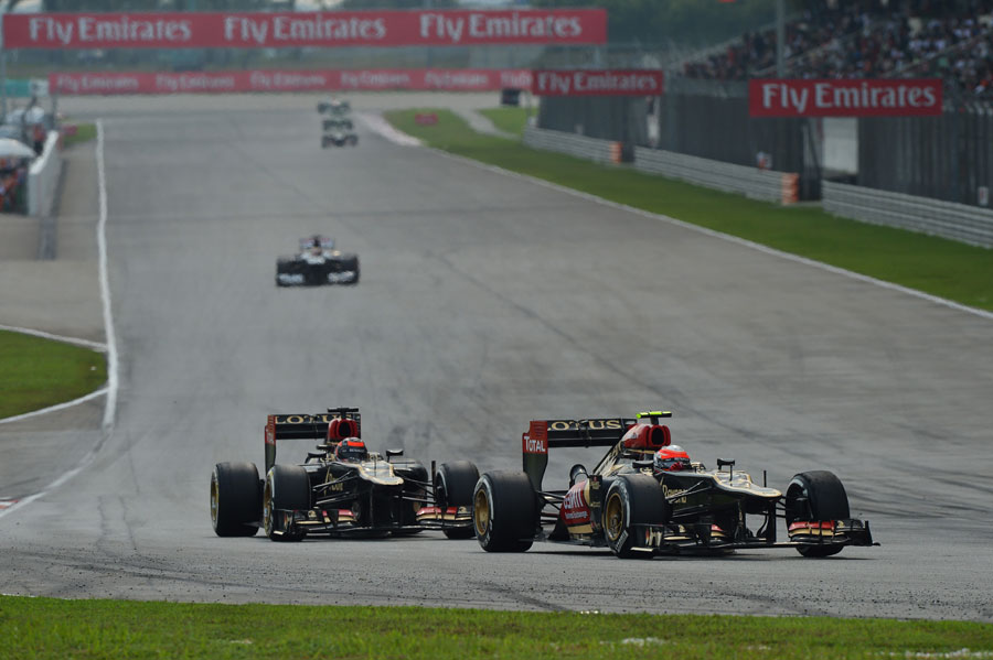 Romain Grosjean leads team-mate Kimi Raikkonen