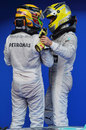 Nico Rosberg and Lewis Hamilton chat in parc ferme