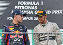 Sebastian Vettel talks to Lewis Hamilton on the podium