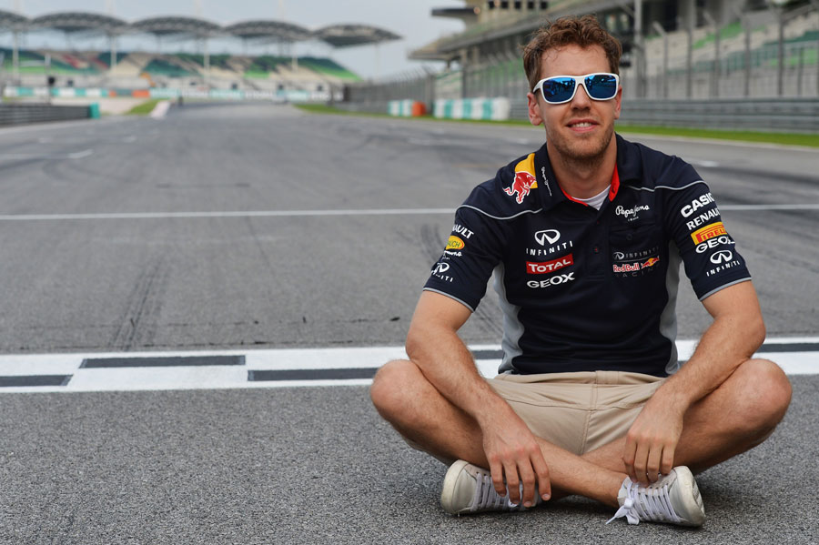 Sebastian Vettel sits by the finish line