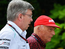 Mercedes bosses Ross Brawn and Niki Lauda walk through the paddock