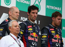 Adrian Newey, Mark Webber and Sebastian Vettel share an uneasy podium