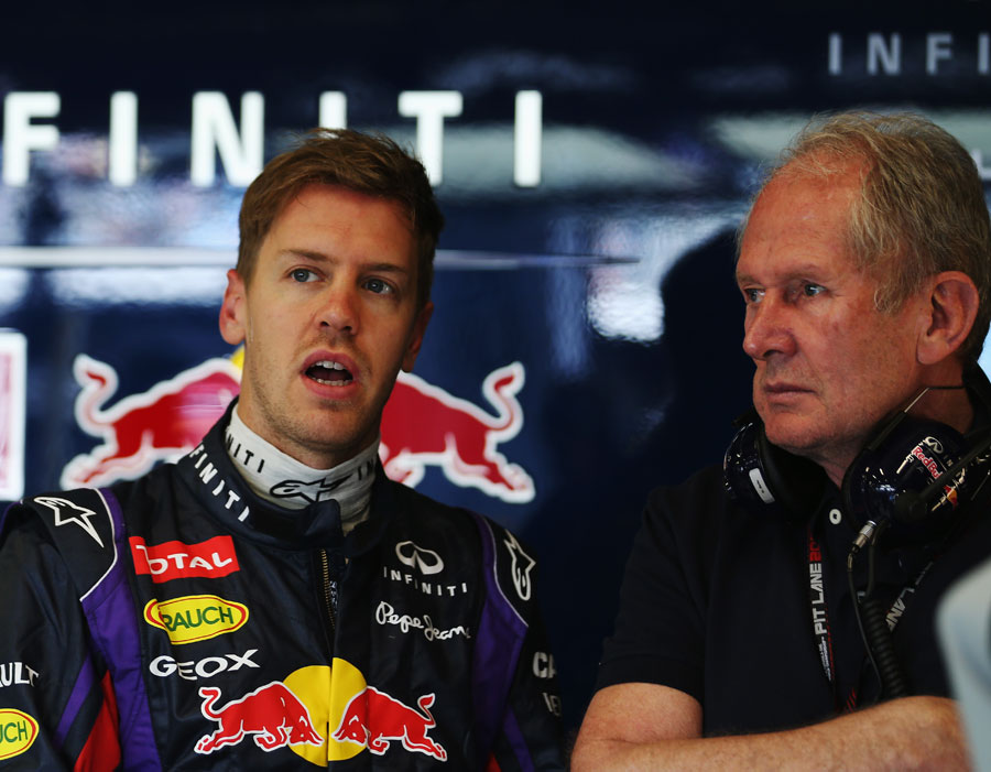 Sebastian Vettel and Mark Webber in the Red Bull garage