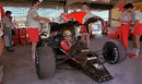Mechanics replace the bodywork after working on Ayrton Senna's car