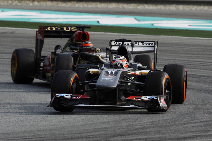 Nico Hulkenberg holds off Kimi Raikkonen