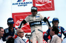 Nelson Piquet on the verge of collapse on the podium