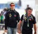 Romain Grosjean arrives in the paddock with his trainer Benoit Campargue