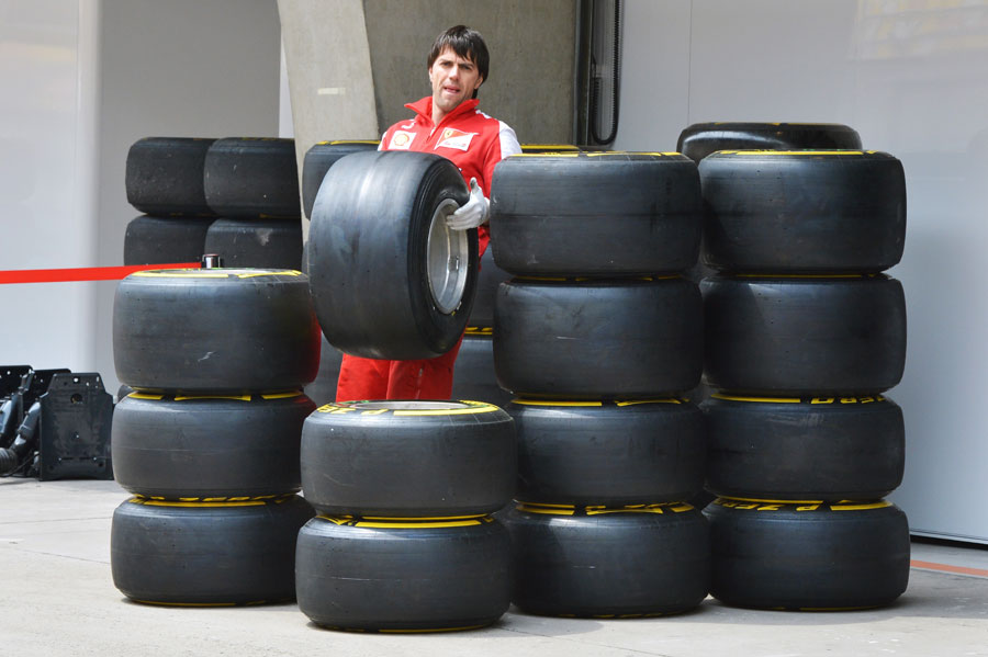 A Ferrari mechanic organises the team's allocation of Pirelli tyres