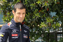 Mark Webber walks through the paddock with a new haircut