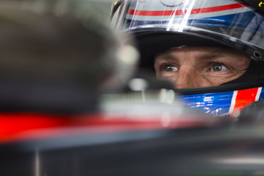 A focused Jenson Button in his McLaren cockpit