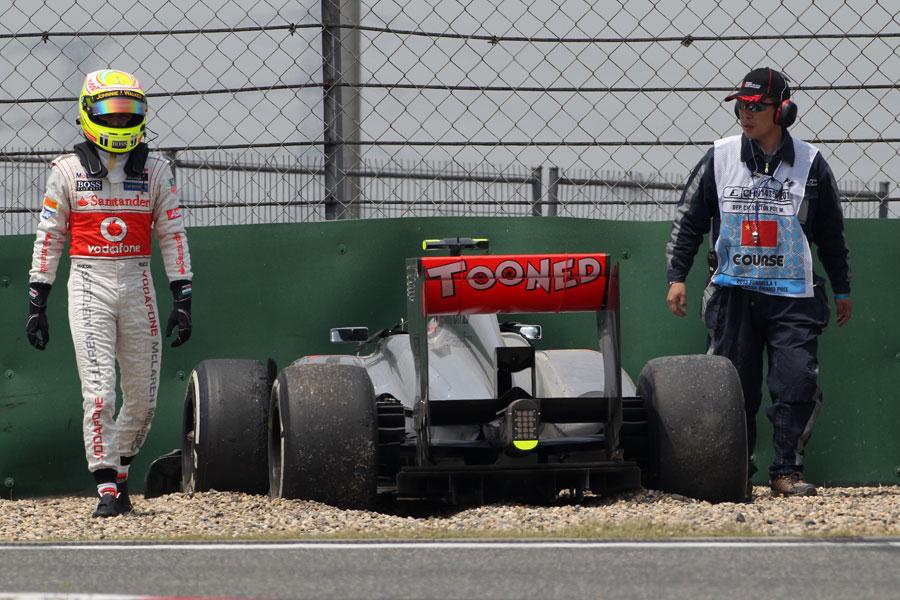 Sergio Perez walks away after crashing his McLaren in the pit lane