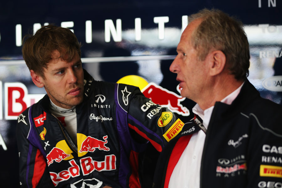 Sebastian Vettel talks to Helmut Marko in the Red Bull garage