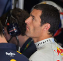 Mark Webber analyses data in the garage