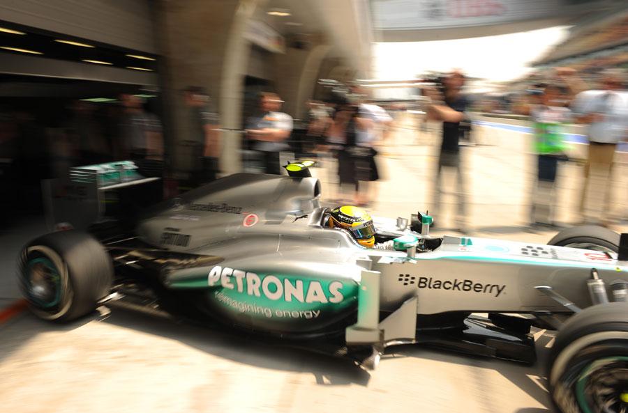 Lewis Hamilton leaves the Mercedes garage on medium tyres