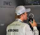 Nico Rosberg keeps an eye on the timing screens