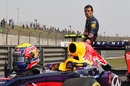Mark Webber stands by his Red Bull after stopping due to a lack of fuel in Q2