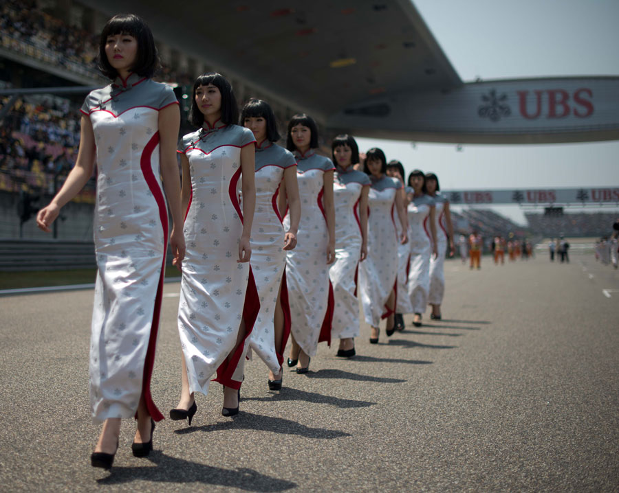 Grid girls get ready for the start of the race