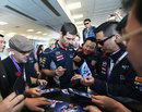 Mark Webber signs autographs for Red Bull VIPs
