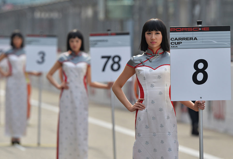 Grid girls line up for a support race