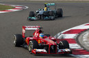Fernando Alonso heads Lewis Hamilton in to turn two