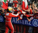 Fernando Alonso celebrates after winning in China