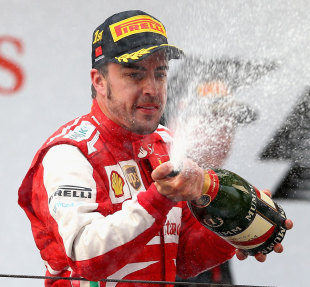 Back on track - Fernando Alonso celebrates  after winning the Chinese Grand Prix
