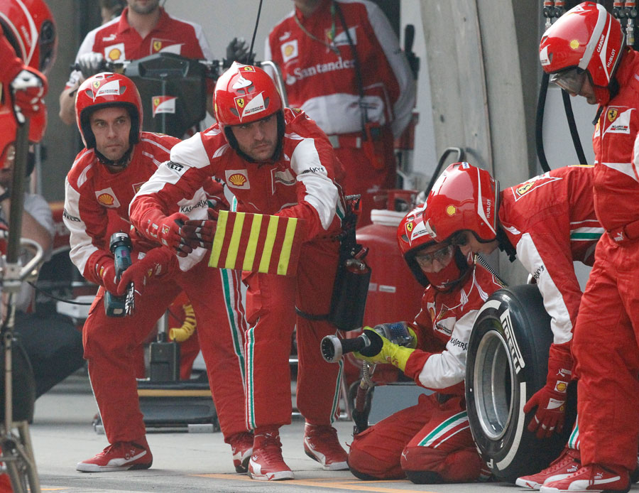 Ferrari mechanics a picture of concentration