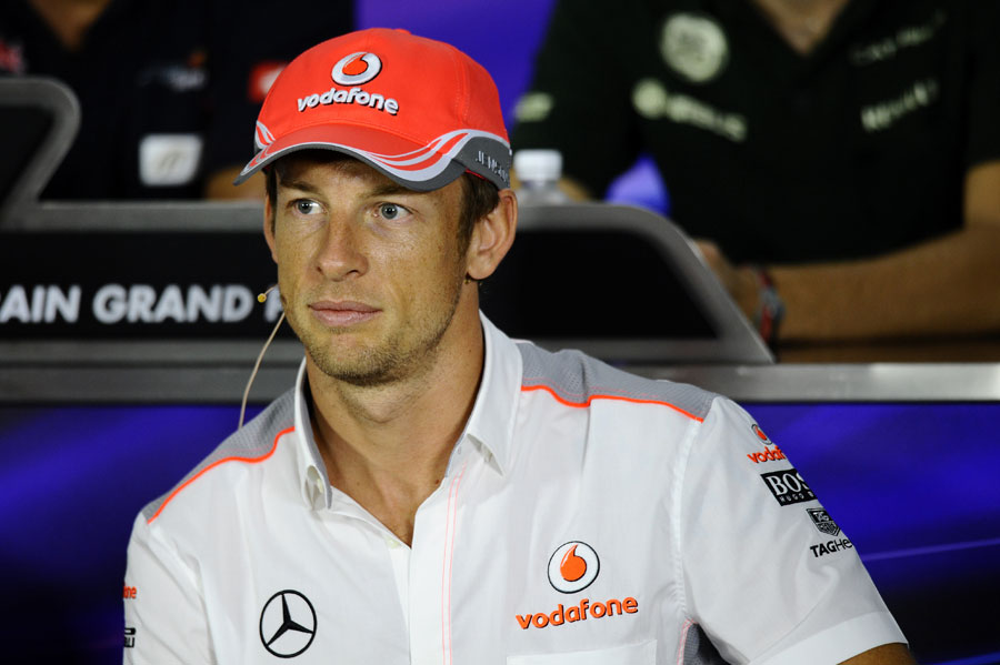 Jenson Button listens intently during the driver press conference