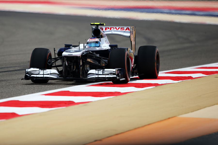 Valtteri Bottas leans on the kerb in the Williams