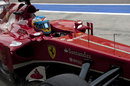 Fernando Alonso returns to the Ferrari pit box
