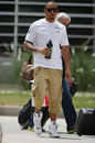 Lewis Hamilton walks through the paddock