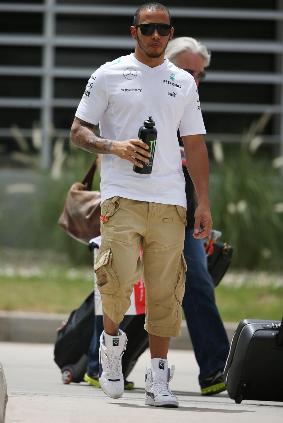 Lewis Hamilton walks through the paddock