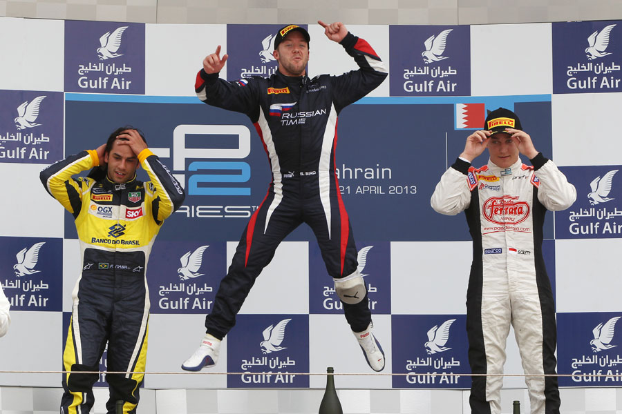 Sam Bird celebrates on the podium with Felipe Nasr and Stefano Coletti