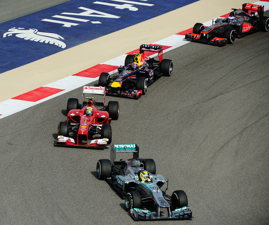 Nico Rosberg leads a gaggle of cars through turn 10