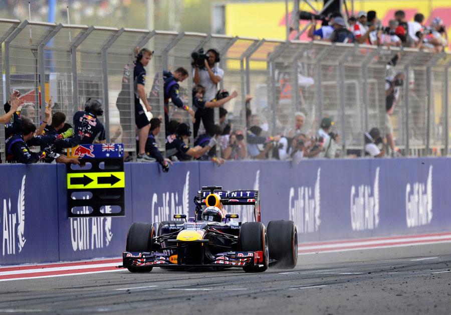 Sebastian Vettel celebrates victory as he crosses the line