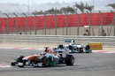 Paul di Resta leads Lewis Hamilton in to Turn 4